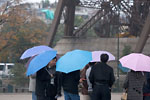 Paris - Blue and pink umbrellas under the Eiffel tower
