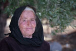 Krista - Smiling old greek woman in black robes
